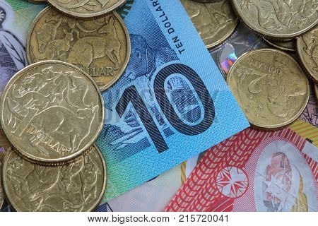 Australian money with one and two dollar coin and ten dollar note.
