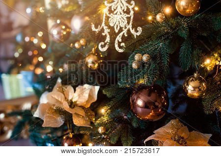 Stylish Christmas interior decorated in white and golden colors. Comfort home. New Year and Christmas