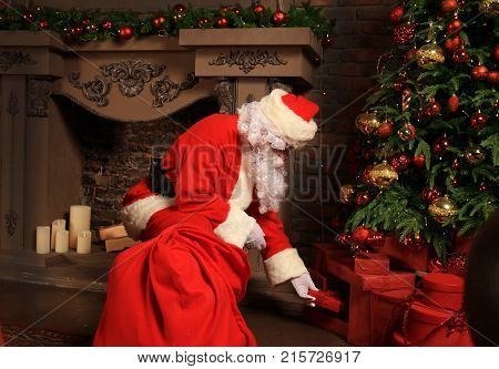 Santa Claus bring the sack with gifts for Christmas