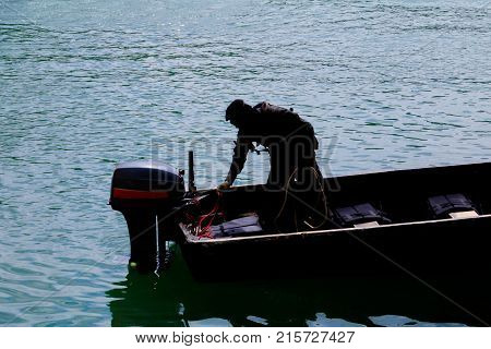 Silhouette soldier on Boat in river with copy space add text