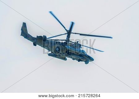 ROSTOV-ON-DON, RUSSIA - CIRCA AUGUST, 2017: Russian Air Force Mil Mi-28 Havoc attack combat helicopter in gray camouflage flying during aerial view during air show in Rostov-on-Don