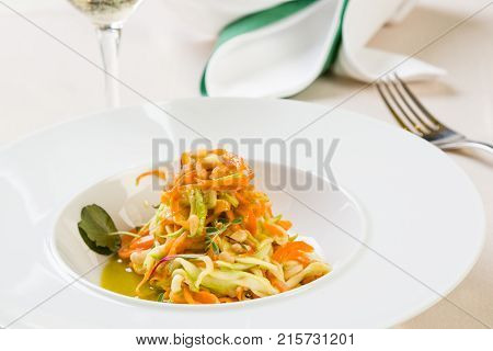 Spaghetti From Carrots And Zucchini With Pesto