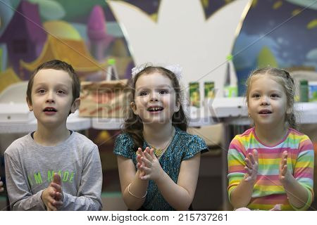 Belarus Gomel November 9 2017. Gomel Children's Center.Enthusiastic children clap. Preschoolers are spectators. Admire the performance. Children's party