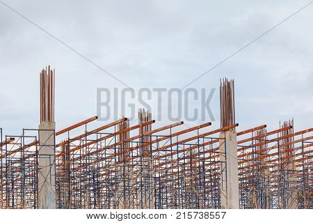 frame post steel in construction workers site and building of housing outdoor. which has storm cloud in sky background with copy space add text