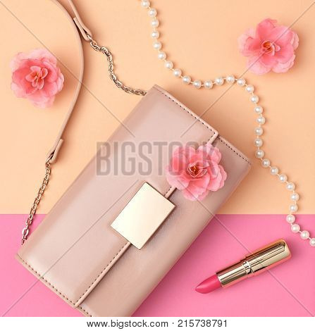 Fashion Design Woman Accessories Set. Pastel Colors.Cosmetic Makeup.Flat lay.Trendy fashion Handbag Clutch clothes. Glamour.Flower. Luxury lady. Art.Minimal