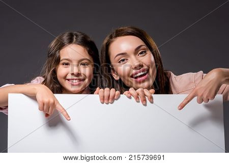 Mother And Daughter Pointing On Something