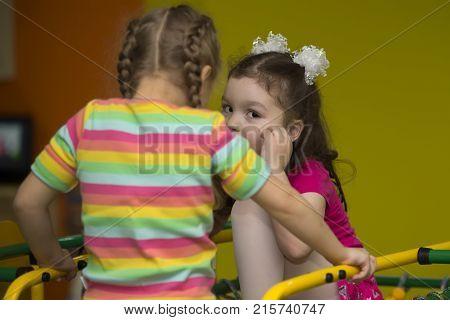 Belarus Gomel November 9 2017. Gomel Children's Center. The girl tells a secret. Children's secrets