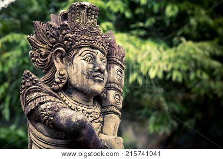 Stone carved balinese statue at Pura Tirta Empul temple. Indonesia.