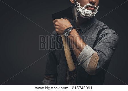 Man Shaving With Axe