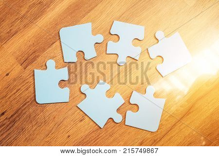 Incomplete jigsaw puzzles on the brown background top view flat lay. The concept of logical thinking conundrum.