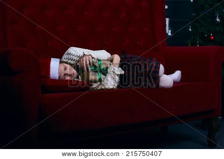 Cute Teen Girl Is Sleeping Sweetly Near A Christmas Tree