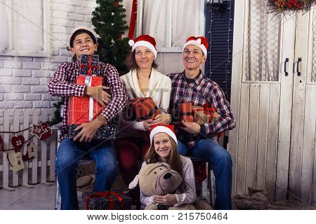 Happy Family, With Gifts In Hands