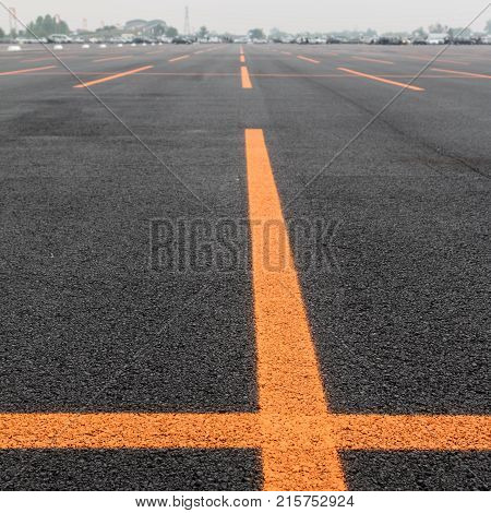 Empty Public Parking Lot with Orange Lines