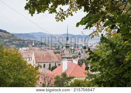 Sighisoara Romania October 08 2017 : View of the old town from the mountain on which the Church of the Deal (St. Nicholas) is located.. Sighisoara city in Romania