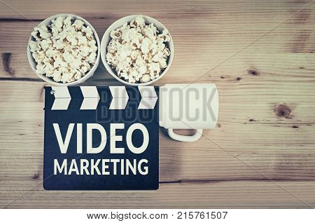 Video marketing concept with movie clapper board