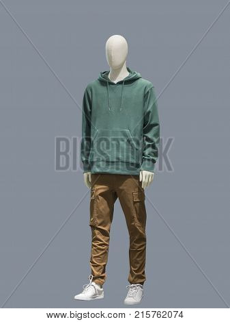 Full-length male mannequin dressed in casual clothes (sweatshirt and trousers) isolated. No brand names or copyright objects.
