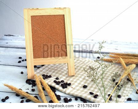 coffee bean and mini board,  Board Bagasse on table.