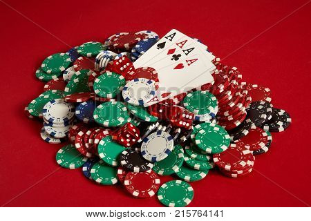 Poker cards and gambling chips on red background. Top view. Copy space. Still life. Flat lay. Cards - four aces. 4 of a kind