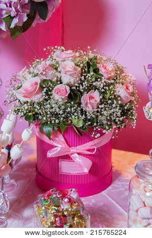 Candy Bar. Bright White Interior With Lots Of Pink Flowers. Pink Powder. Bouquet Of Delicate Pink Fl