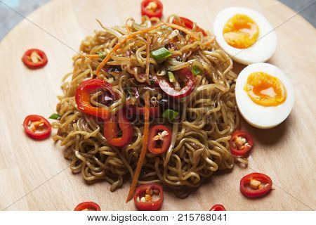 Fried asian instant noodles with egg and vegetables