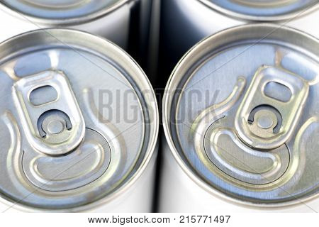 focus on pull tab open of canned of soft drink.