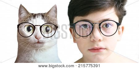 funny photo of teenager kid boy and cat in myopia correction glasses close up portrait
