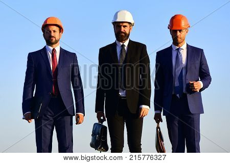 Coworking And Construction Business Concept. Workers And Engineer Hold Meeting
