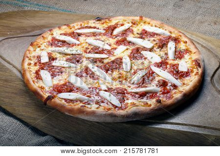 Delicious baked pizza in the wood oven