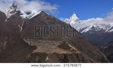 Spring scene in the Sagarmatha National Park Nepal. Village Phortse and famous mountain Ama Dablam.