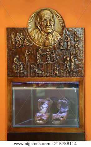 ZAGREB, CROATIA - MARCH 31: Bass relief with scenes from the life of Saint Mother Teresa of Calcutta and her sandals exposed in Chapel of Saint Dismas in Zagreb, Croatia on March 31, 2015