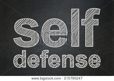 Safety concept: text Self Defense on Black chalkboard background