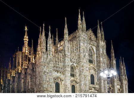 The famous Milan Cathedral (Duomo di Milano) at night in Milan, Italy. Milan Duomo is the largest church in Italy and the fifth largest in the world.