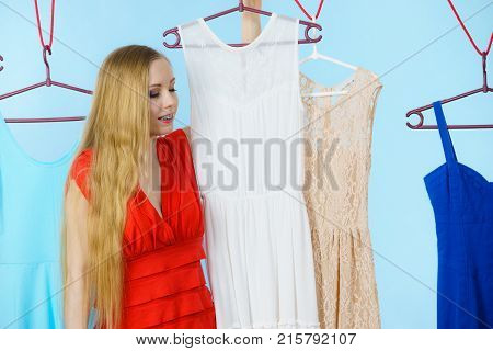 Woman Choosing Clothes In Shop
