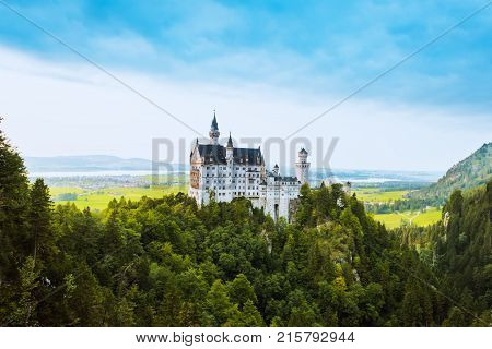 Beautiful aerial view of Neuschwanstein castle in summer season. Palace situated in Bavaria, Germany. Neuschwanstein castle one of the most popular palace and travel destination in Europe and world.