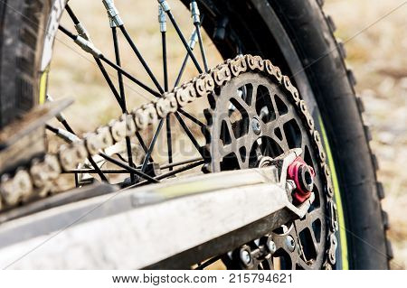 rear wheel motorcycle trial and enduro. Mounted on the wheel gear and chain with spokes. Close-up of the rear wheel of an off-road motorcycle