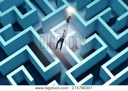 Businessman escaping from maze on balloon