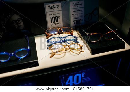 STRASBOURG FRANCE - NOV 21 2017: Colourful fashionable acetate optical glasses and sale offers on display in French manufacturer store window