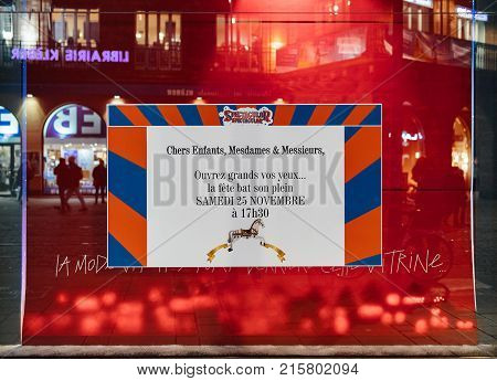 STRASBOURG FRANCE - NOV 21 2017: Galeries Lafayette shop window announcing festive opening of Christmas spectacle with invitation and shopping Spectacular Show