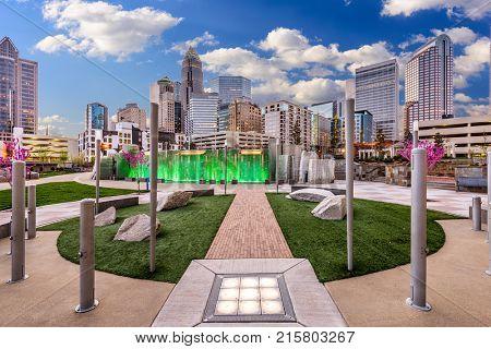 CHARLOTTE, NORTH CAROLINA - APRIL 27, 2015: Uptown skyline and park.