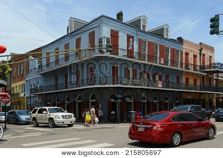 NEW ORLEANS - MAY. 29, 2017: Historic Buildings at the corner of Decatur Street and Toulouse Street in French Quarter in New Orleans, Louisiana, USA.