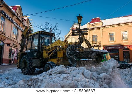 Snow Removal On Streets Of Old Town