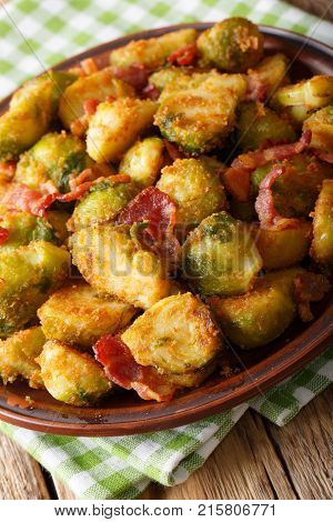 Roasted Brussels Sprouts In Breadcrumbs With Crispy Bacon Close-up On Plate. Vertical