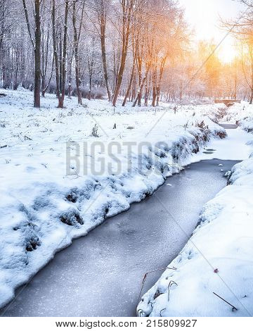 Scenic view of the frozen river. Frosty sunset
