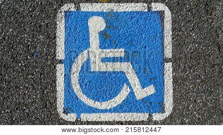 Parking place for handicapped on asphalt background
