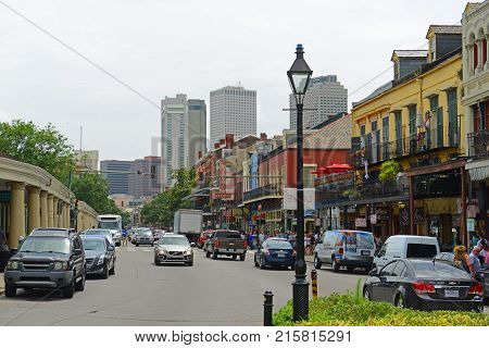 NEW ORLEANS - MAY. 29, 2017: Historic Buildings on Decatur Street between Dumaine Street and St Philip Street in French Quarter in New Orleans, Louisiana, USA.