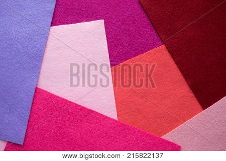 Fan of colored bright felt textile material. Samples of soft felt flaps in different colours. Felt craft abstract handicraft background for handmade and creative