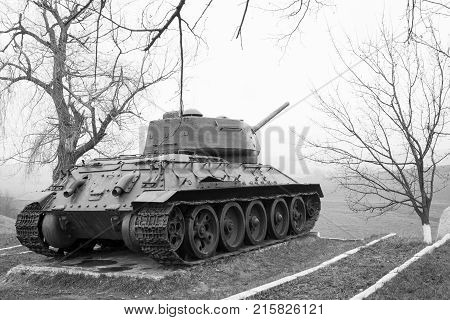 Spring day. In the frame a tank a war a victory. Village. Horizontal frame. Photo taken in Ukraine Kiev. Black and white image