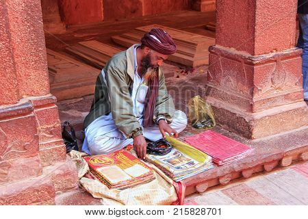 Fatehpur Sikri, India-january 30: Unidentified Man Sells Goods In The Courtyard Of Jama Masjid On Ja