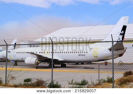 November 27, 2017 in Victorville, CA:  Retired airliner aircraft being stored at the Victorville Airport Aircraft Boneyard in Victorville, CA where airlines and other aviation services can retire older aircraft to be resold or scrapped for parts