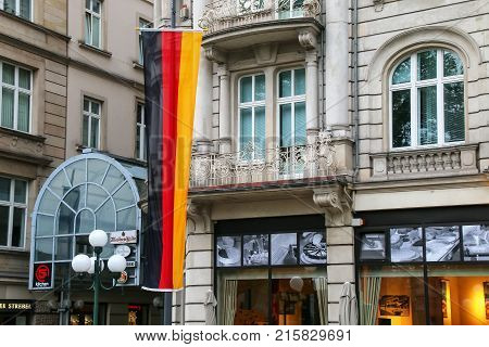 Wiesbaden, Germany - May 24: National Flag Of Germany Next To A Building On May 24, 2017 In Wiesbade
